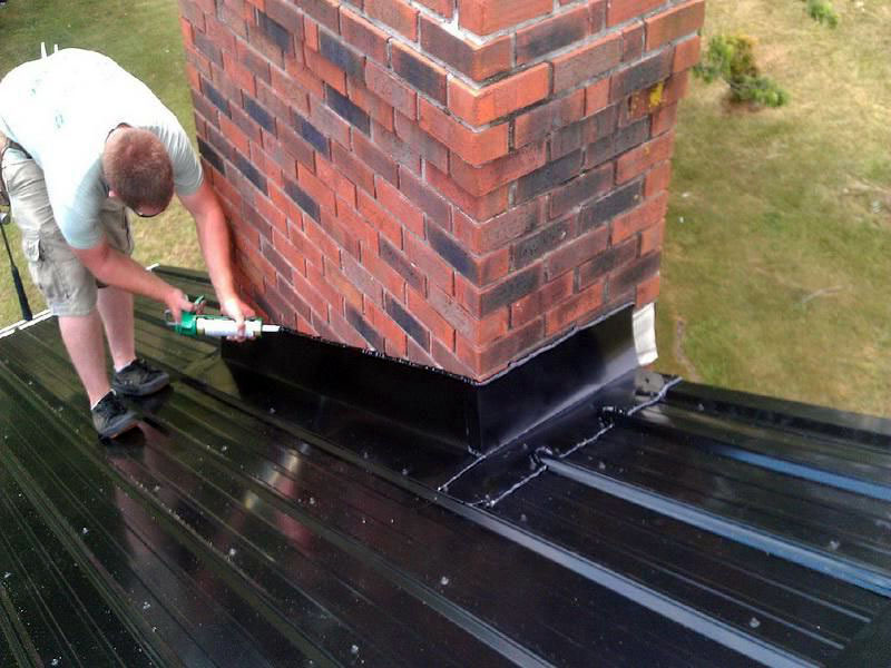 How To Seal A Metal Roof Around A Chimney? [Step-By-Step Guide]