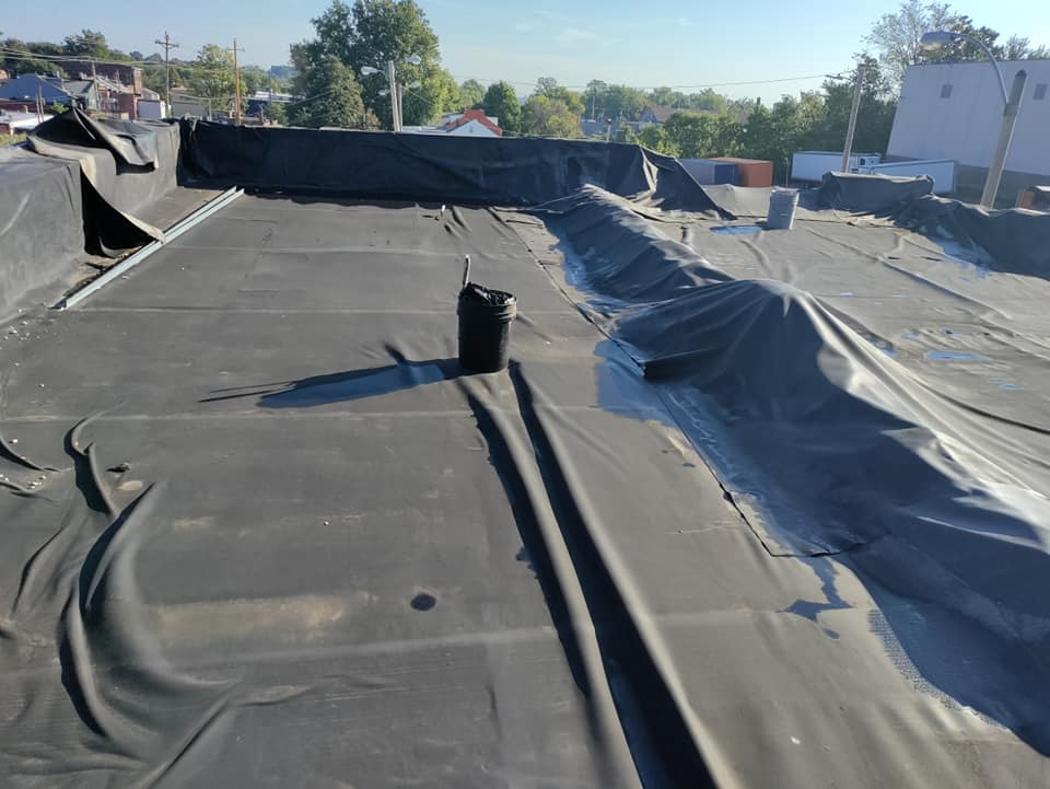 how to tarp a flat roof